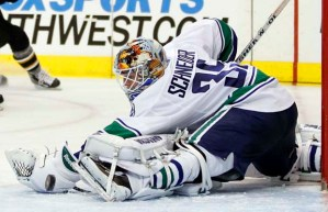 Canucks goaltender Schneider protects the net against the Stars during their NHL hockey game in Dallas