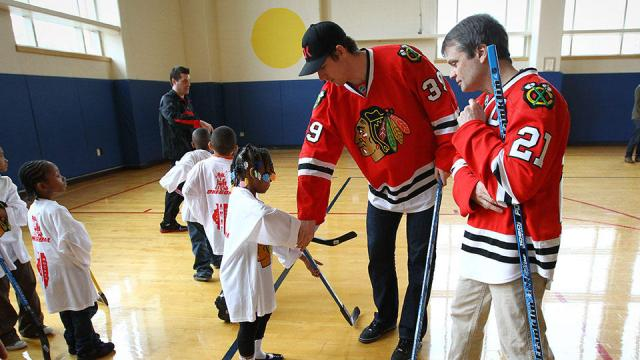 Rep. Mike Quigley and former Hawk Jimmy Hayes teaching hockey in Chicago