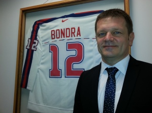 Amb. Kmec with Peter Bondra's Slovak national team jersey, hanging at the embassy (Doug Johnson)