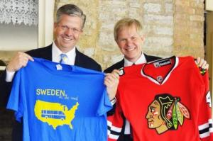 Amb. Lyrvall with Rep.Hultgren, exchanging sweaters.